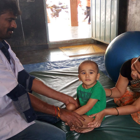 Child with disability receiving therapy at SIS, APD India