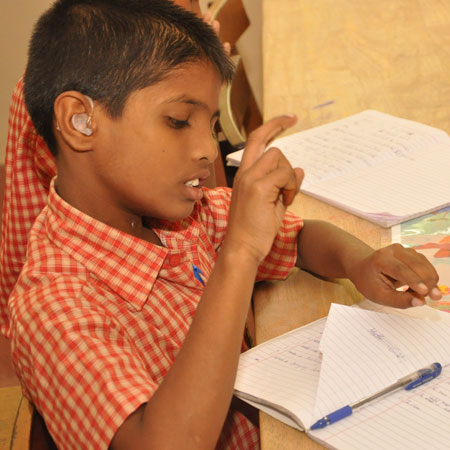 Child with disability receiving education at SIS, APD India