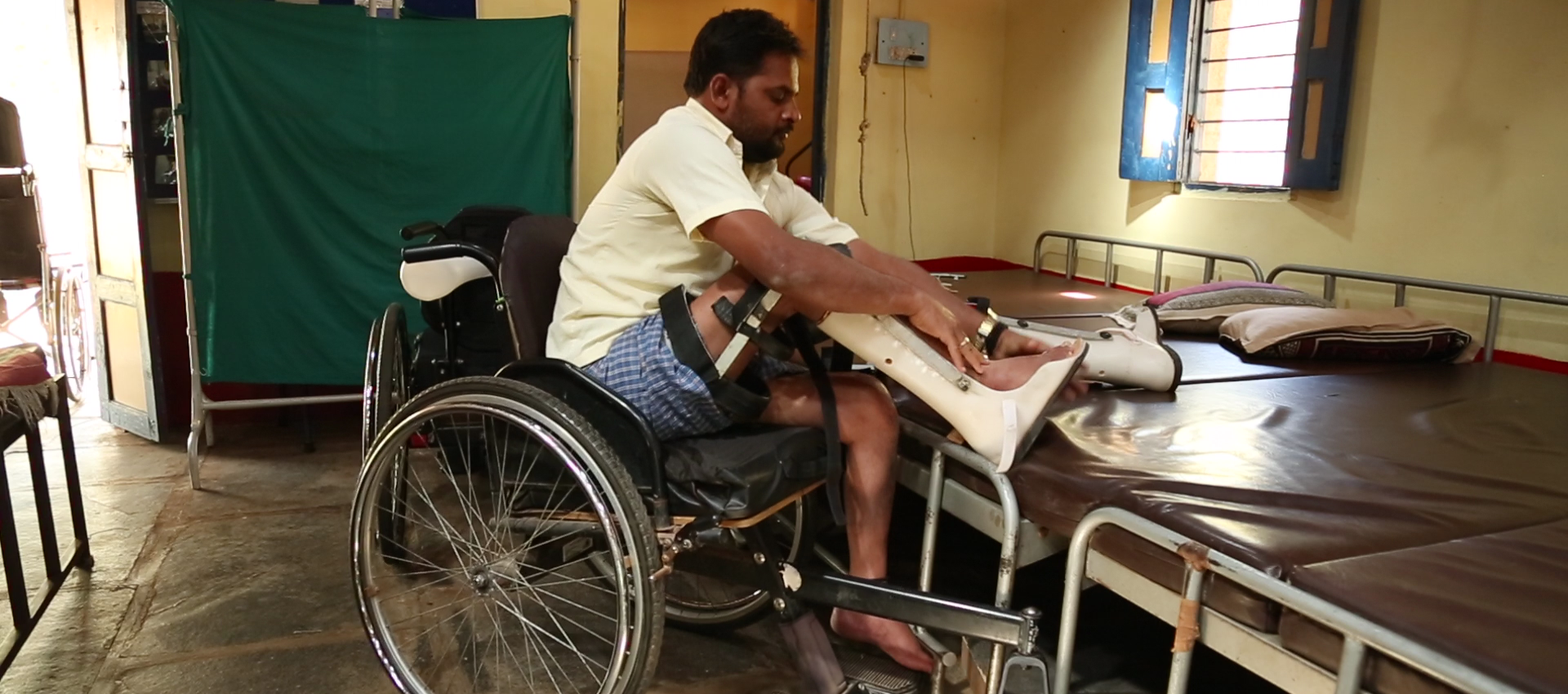 Person with Spinal Cord Injury fitting his Assistive Devices and Mobility Aids | APD India