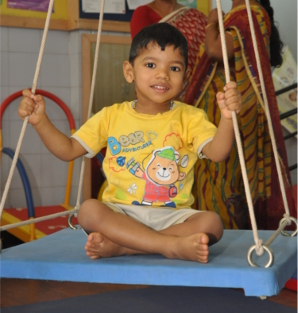 Child receiving therapy through play at APD, Lingarajapuram
