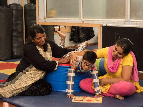 Child Getting Therapy Through Play for Early Disability Management