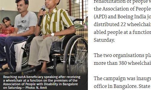 A beneficiary speaking after receiving a wheelchair at a function on the premises of the Association of People with Disability, Bangalore