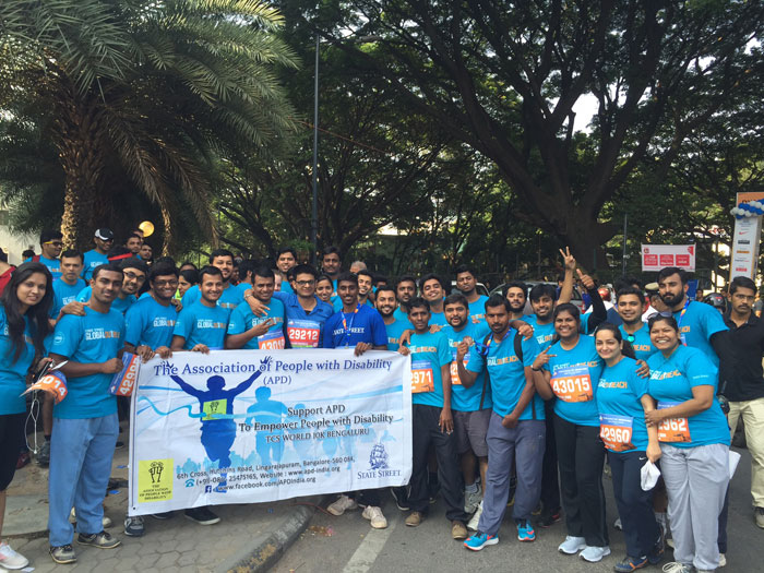 Team of corporate volunteers at the TCS 10K Marathon for APD India